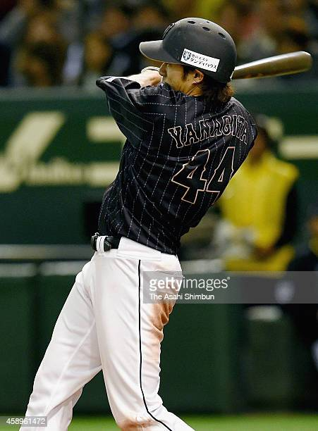 Yuki Yanagita of Samurai Japan hits a RBI single in the top of 4th inning during the game two of Samurai Japan and MLB All Stars at Tokyo Dome on...