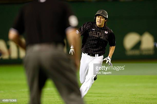 Yuki Yanagita of Samurai Japan hits a tworun RBI triple in the second inning during the game against the MLB AllStars at the Tokyo Dome during the...