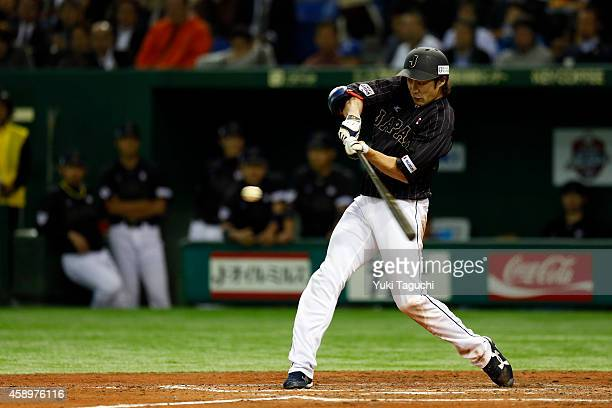 Yuki Yanagita of Samurai Japan hits an RBI single in the fourth inning during the game against the MLB AllStars at the Tokyo Dome during the Japan...