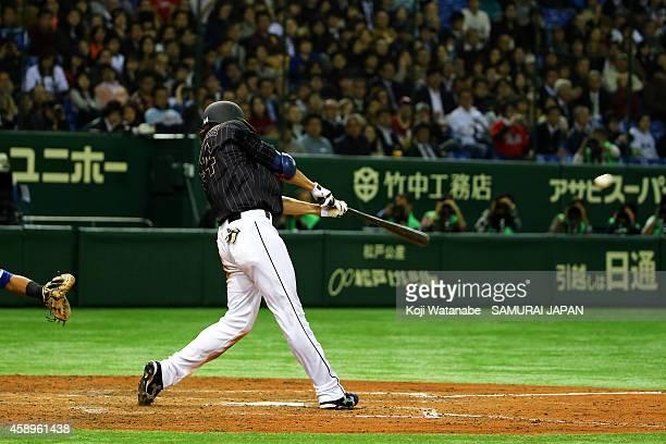 Yuki Yanagita of Samurai Japan hits to the center field sending one runner home in the eighth inning during the game two of Samurai Japan and MLB All...