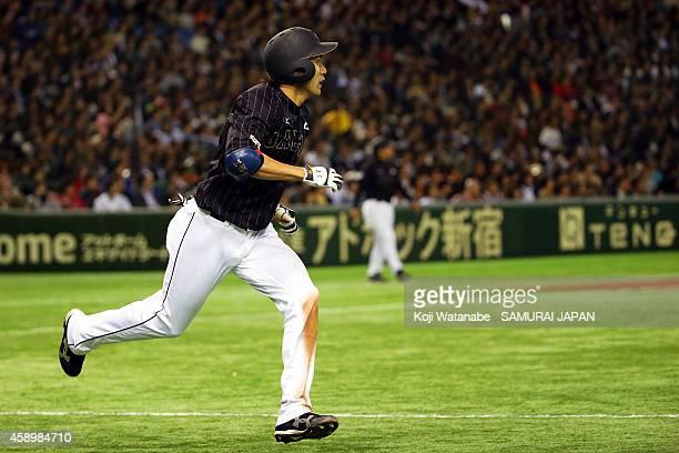 Yuki Yanagita of Samurai Japan hits to the center field sending one runner home in the eighth inning during game two of Samurai Japan and MLB...