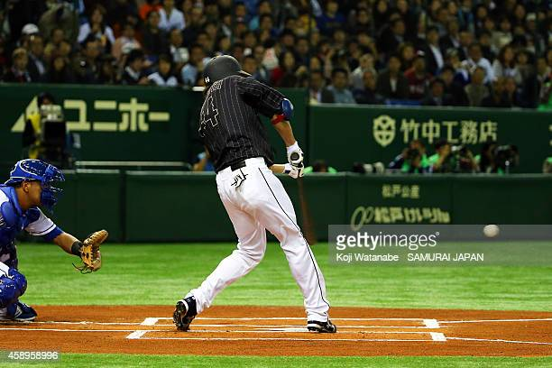 Yuki Yanagita of Samurai Japan hits to the right field sending one runner home in the fourth inning during the game two of Samurai Japan and MLB All...