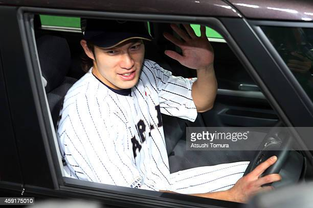 Yuki Yanagita of Samurai Japan poses in the Suzuki SPACIA after the game five of Samurai Japan and MLB All Stars at Sapporo Dome on November 18 2014...