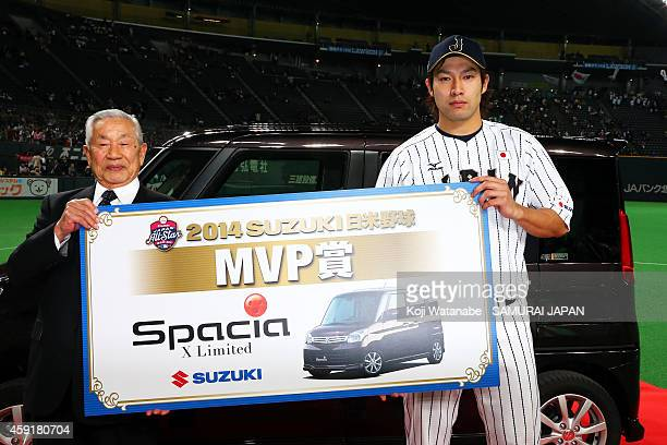 Yuki Yanagita of Samurai Japan poses with Suzuki SPACIA after during the game five of Samurai Japan and MLB All Stars at Sapporo Dome on November 18...