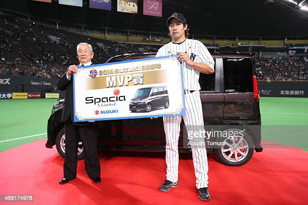 Yuki Yanagita of Samurai Japan poses with Suzuki SPACIA after the game five of Samurai Japan and MLB All Stars at Sapporo Dome on November 18 2014 in...