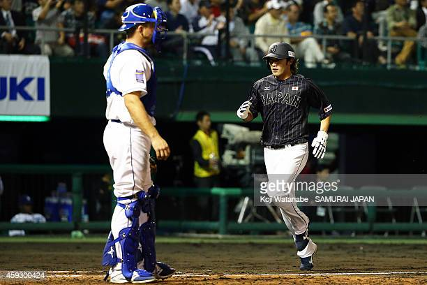 Yuki Yanagita of Samurai Japan runs to the home plate in the top half of the eighth inning celerates during the exhibition game between Samurai Japan...