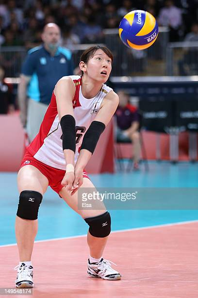 Yukiko Ebata of Japan returns serve in the Women's Volleyball Preliminary match between Italy and Japan on Day 3 of the London 2012 Olympic Games at...