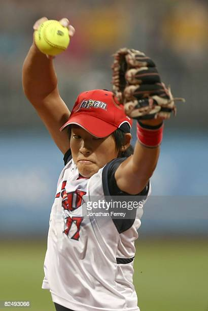 Yukiko Ueno of Japan delivers a pitch against the United States during the women's gold medal game held at the Fengtai Softball Field during Day 13...