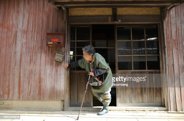 Yukiko Watanabe steps out of her house on Gogo Island in Matsuyama Ehime Prefecture Japan on Friday March 22 2013 A combination of the world's...