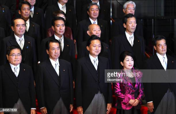 Yukio Hatoyama Japan's prime minister center poses for a photograph with his newly appointed cabinet members at the prime minister's official...