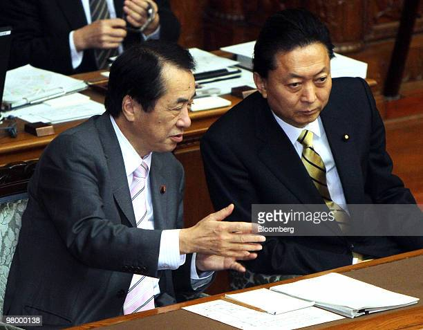 Yukio Hatoyama Japan's prime minister right speaks with Naoto Kan Japan's finance minister at the upper house of the Diet in Tokyo Japan on Wednesday...