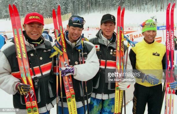 Yukio Mochizuki Kyoji Suga Atsushi Kazama and Shuichi Sekiya of Japan pose for photographs after competing in the Men's Relay during the IBU Biathlon...