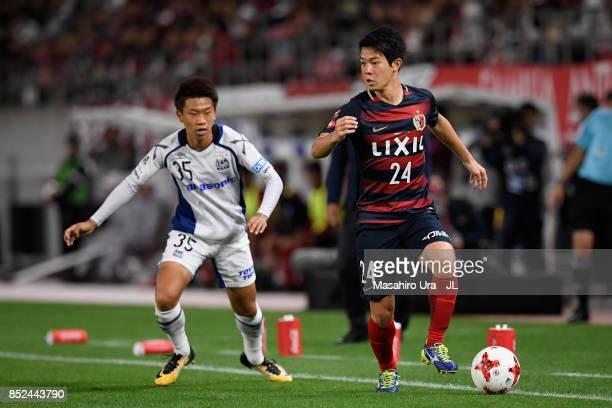 Yukitoshi Ito of Kashima Antlers and Ryo Hatsuse of Gamba Osaka compete for the ball during the JLeague J1 match between Kashima Antlers and Gamba...