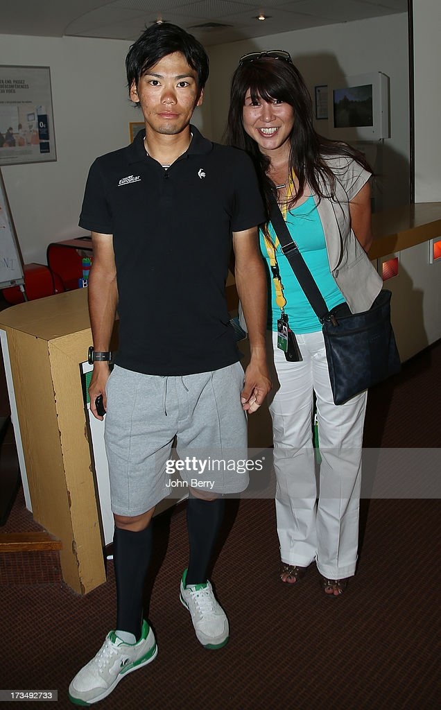 Yukiya Arashiro of Japan and Team Europcar and his wife Iijima Miwa pose at his hotel during the second rest day of the 2013 Tour de France on July 15, 2013 in Avignon, Vaucluse, France.