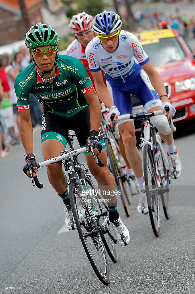 Yukiya Arashiro of Japan riding for Europcar leads the breakaway group with Anthony Delaplace of France riding for Saur-Sojasun and <a gi-track='captionPersonalityLinkClicked' href=/galleries/search?phrase=David+Moncoutie&family=editorial&specificpeople=749993 ng-click='$event.stopPropagation()'>David Moncoutie</a> of France riding for Cofidis during stage four of the 2012 Tour de France from Abbeville to Rouen on July 4, 2012 in Rouen, France.