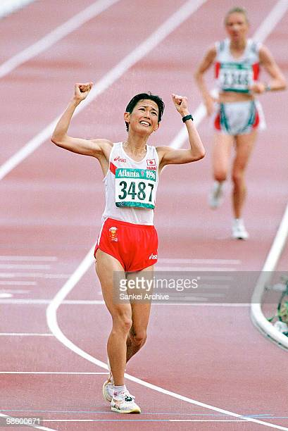 Yuko Arimori crosses the line to win the blonze medal in the Women's Marathon during the Atlanta Olympics at the Olympic Stadium on July 28 1996 in...