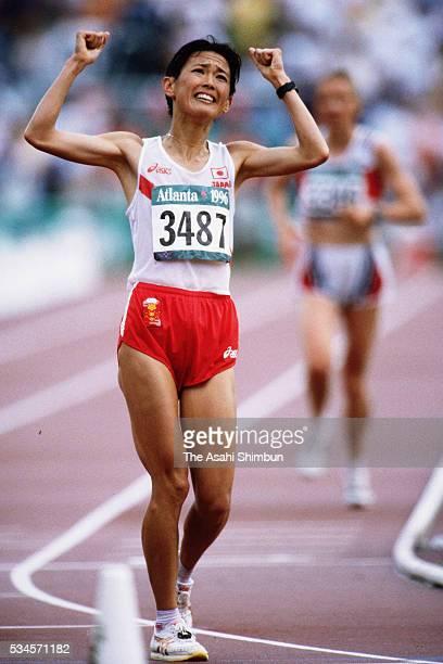 Yuko Arimori of Japan celebrates winning the bronze in the Women's marathon during the Atlanta Summer Olympic Games at the Centennial Olympic Stadium...
