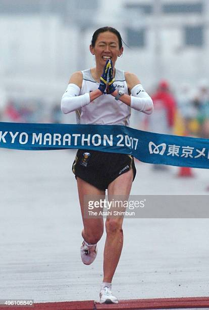 Yuko Arimori of Japan reacts as she finishes the Women's Marathon during the Tokyo Marathon 2007 at Tokyo Big Sight on February 18 2007 in Tokyo Japan