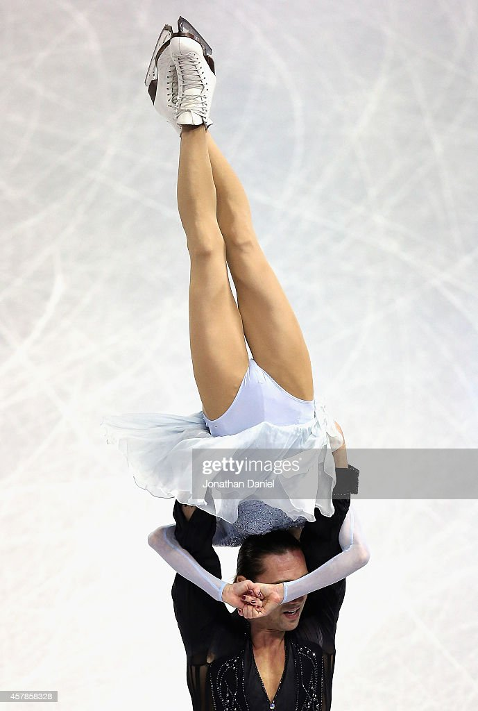 Yuko Kavaguti and <a gi-track='captionPersonalityLinkClicked' href=/galleries/search?phrase=Alexander+Smirnov&family=editorial&specificpeople=4045603 ng-click='$event.stopPropagation()'>Alexander Smirnov</a> compete in the Pairs Short Program during the 2014 Hilton HHonors Skate America competition at the Sears Centre Arena on October 25, 2014 in Hoffman Estates, Illinois.
