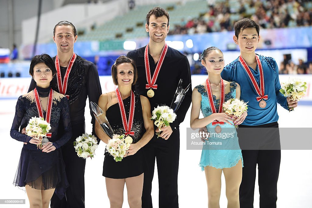 Yuko Kavaguti and <a gi-track='captionPersonalityLinkClicked' href=/galleries/search?phrase=Alexander+Smirnov&family=editorial&specificpeople=4045603 ng-click='$event.stopPropagation()'>Alexander Smirnov</a> of Russia (Silver), <a gi-track='captionPersonalityLinkClicked' href=/galleries/search?phrase=Meagan+Duhamel&family=editorial&specificpeople=2076875 ng-click='$event.stopPropagation()'>Meagan Duhamel</a> and <a gi-track='captionPersonalityLinkClicked' href=/galleries/search?phrase=Eric+Radford&family=editorial&specificpeople=5587908 ng-click='$event.stopPropagation()'>Eric Radford</a> of Canada (Gold) and Xiaoyu Yu and Yang Jin of China (Bronze) pose with medal in the victory ceremony during day two of ISU Grand Prix of Figure Skating 2014/2015 NHK Trophy at the Namihaya Dome on November 29, 2014 in Osaka, Japan.
