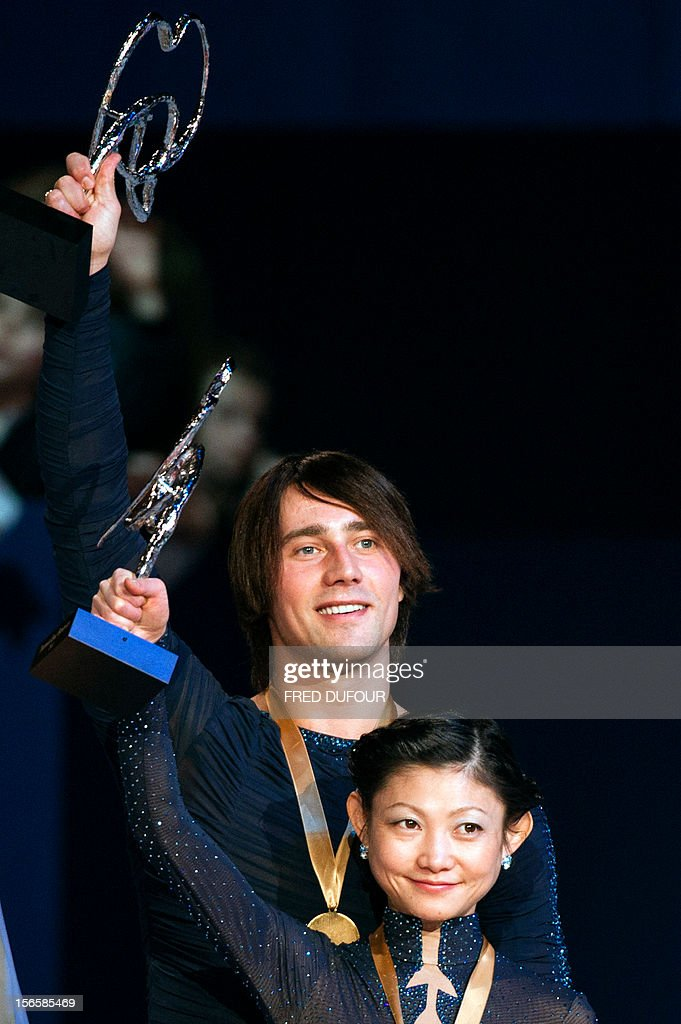 Yuko Kavaguti and Alexander Smirnov of Russia wave after taking the first place in the pairs free skating event of the Trophee Eric Bompard, the fifth in the six-round ISU Grand Prix figure skating series, on November 17, 2012 at Bercy congress hall (POPB) in Paris.