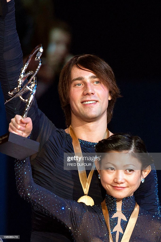 Yuko Kavaguti and Alexander Smirnov of Russia wave after taking the first place in the pairs free skating event of the Trophee Eric Bompard, the fifth in the six-round ISU Grand Prix figure skating series, on November 17, 2012 at Bercy congress hall (POPB) in Paris. AFP PHOTO / FRED DUFOUR
