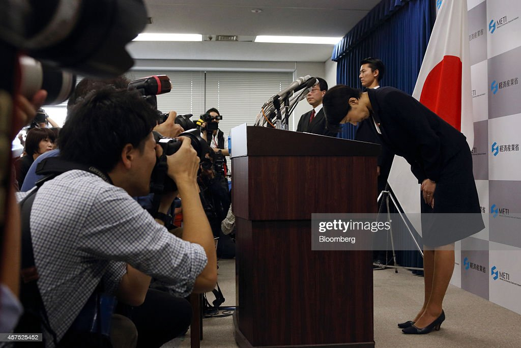 Yuko Obuchi, Japan's economy, trade and industry minister, bows during a news conference in Tokyo, Japan, on Monday, Oct. 20, 2014. Obuchi will step down today over allegations that her support groups misused political funds, Japanese media including the Sankei newspaper reported yesterday, adding that Prime Minister Shinzo Abe will accept her resignation. Photographer: Tomohiro Ohsumi/Bloomberg via Getty Images