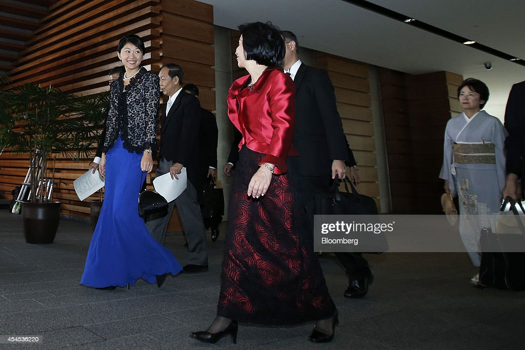 Yuko Obuchi Japan's newly appointed economy trade and industry minister left walks through the prime minister's official residence with Shunichi...
