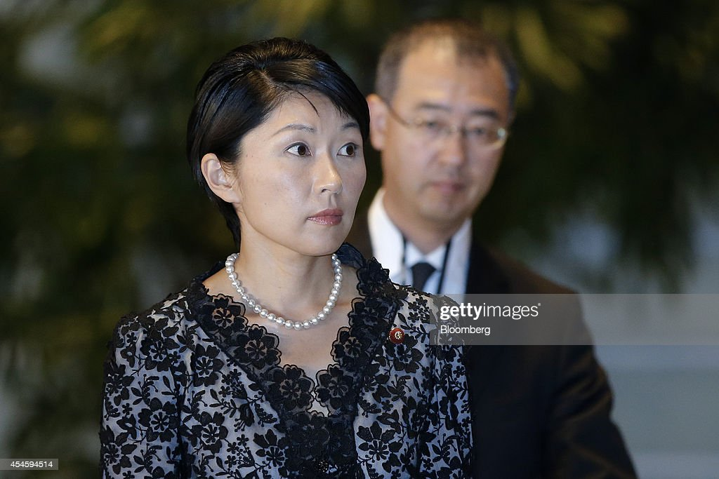 Yuko Obuchi, Japan's newly appointed economy, trade and industry minister, left, arrives at the prime minister's official residence after the attestation ceremony at the Imperial Palace in Tokyo, Japan, on Wednesday, Sept. 3, 2014. Japanese Prime Minister Shinzo Abe placed an advocate of pro-market reforms in charge of the government pension fund and named a rising female politician as industry minister as he seeks to restore momentum to his 'Abenomics' policies with a cabinet reshuffle today. Photographer: Kiyoshi Ota/Bloomberg via Getty Images