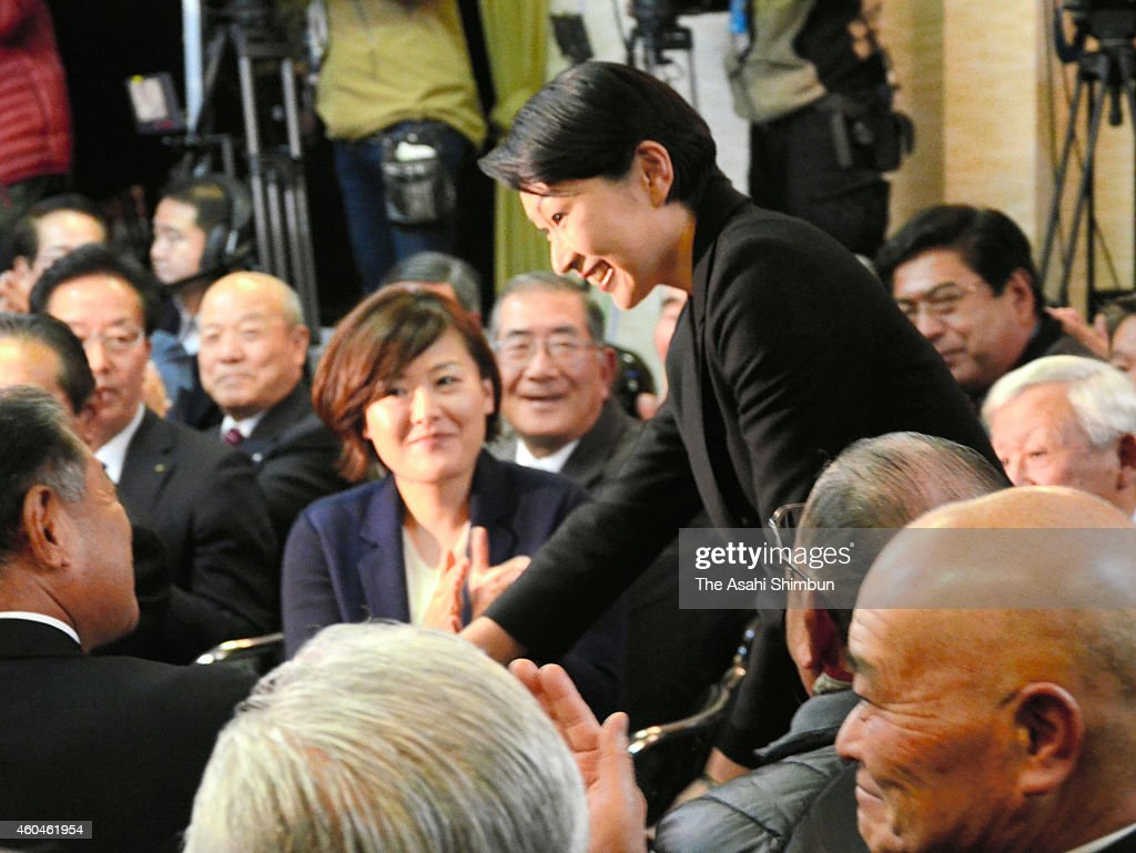 Yuko Obuchi (C) of the Liberal Democratic Party talks with her supporters after her win in the Gunma No.5 constituency on December 14, 2014 in Takasaki, Gunma, Japan. Ruling Liberal Democratic Party and its junior coalition Komeito are likely to secure two-thirds of the seats, will enable Prime Minister Shinzo Abe to push on policies such as re-interpretation of Constitution on collective self-defense, and future of the nuclear energy as well as 'Abenomics'.