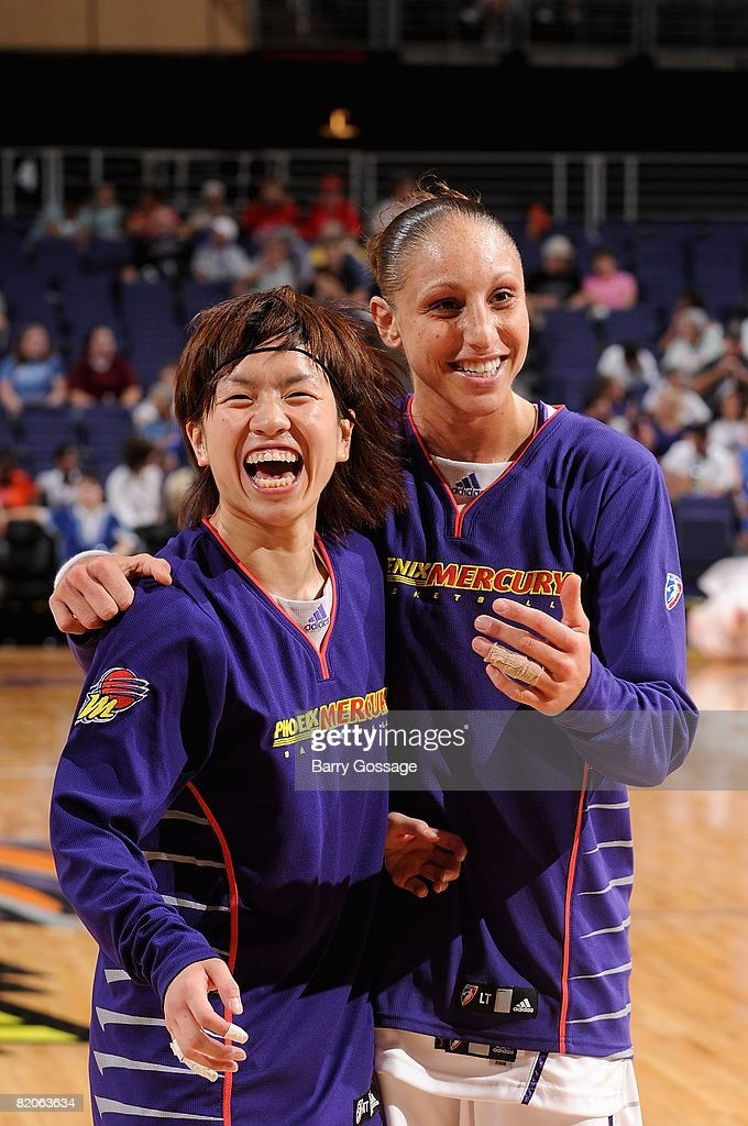 Yuko Oga and Diana Taurasi of the Phoenix Mercury share a laugh before the WNBA game against the New York Liberty on July 5 2008 at US Airways Center...