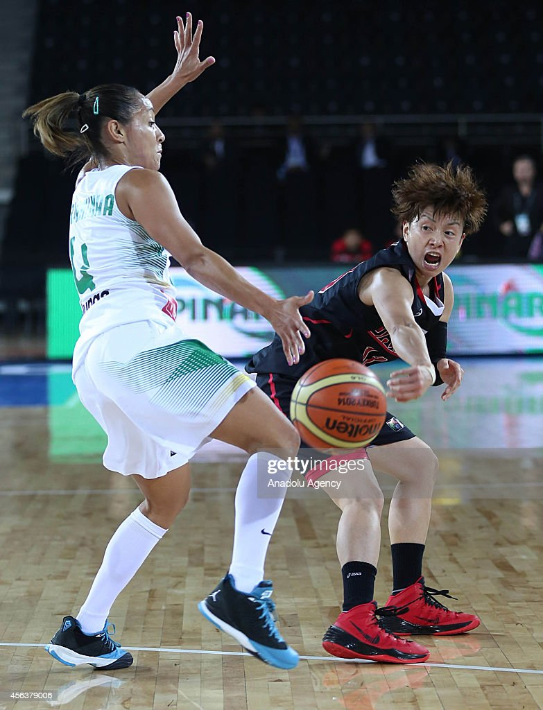 Yuko Oga of Japan in action against Adriana Pinto of Brazil during the 2014 FIBA World Championship For Women Group A basketball match between Japan...