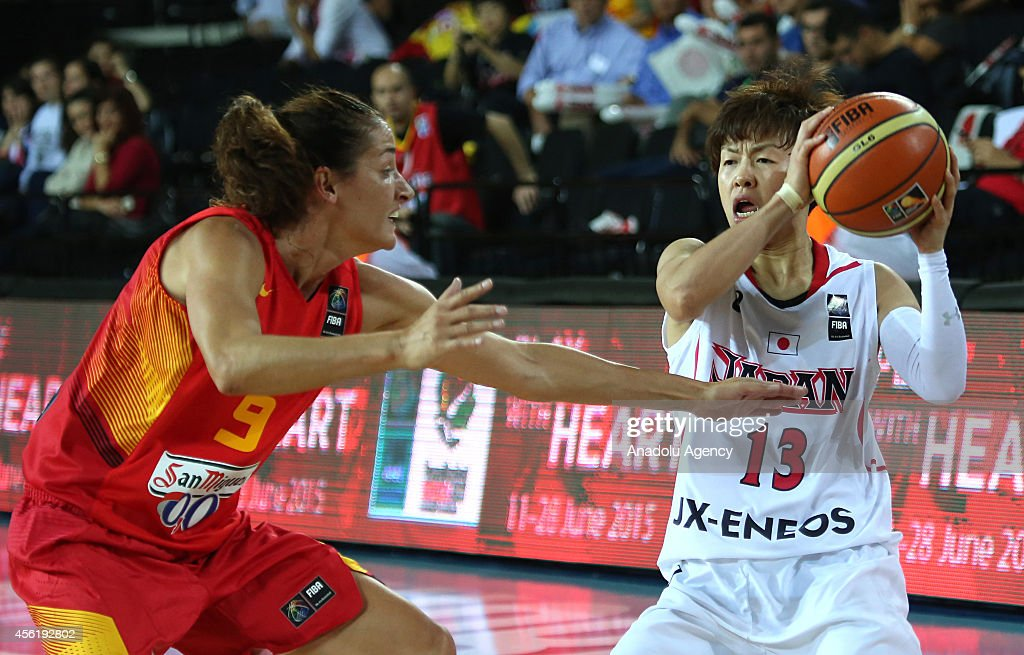 Yuko Oga of Japan in action against Laia Palau of Spain during the 2014 FIBA World Championship For Women Group A basketball match between Japan and...
