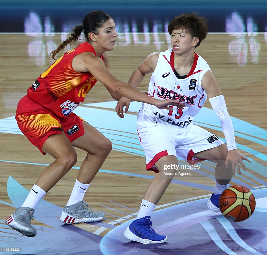 Yuko Oga of Japan in action against Marta Xargay of Spain during the 2014 FIBA World Championship For Women Group A basketball match between Japan...