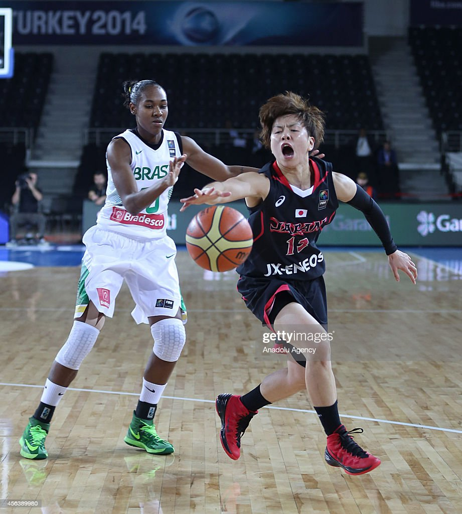 Yuko Oga of Japan in action against Tatiane Pacheco of Brazil during the 2014 FIBA World Championship For Women Group A basketball match between...