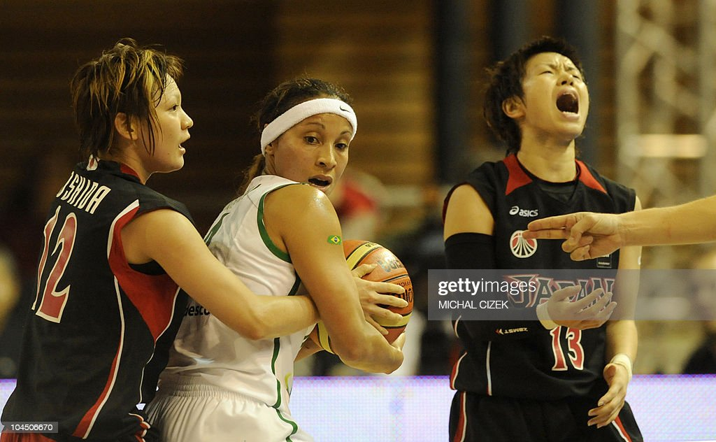 Yuko Oga of Japan reacts as her teammate Asami Yoshida fights for a ball with Adriana Pinto of Brasil during the World Championship women basketball...