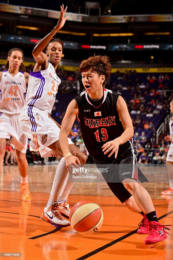 Yuko Oga #13 of the Japanese National Team drives against DeWanna Bonner #24 of the Phoenix Mercury during a WNBA preseason game on May 19, 2013 at U.S. Airways Center in Phoenix, Arizona.