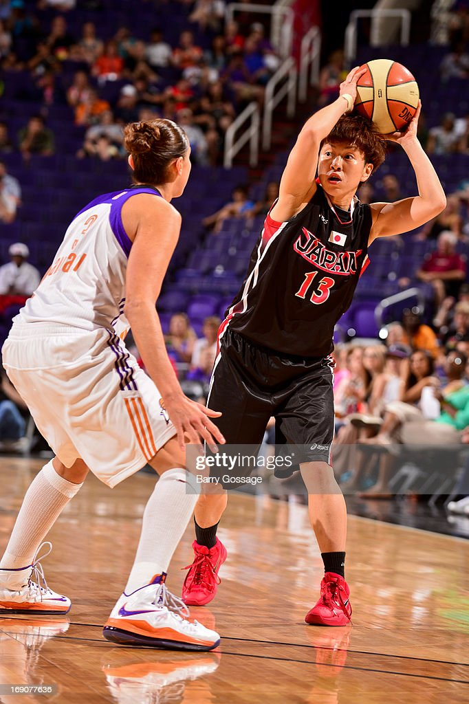 Yuko Oga of the Japanese National Team looks to pass the ball against Diana Taurasi of the Phoenix Mercury during a WNBA preseason game on May 19...
