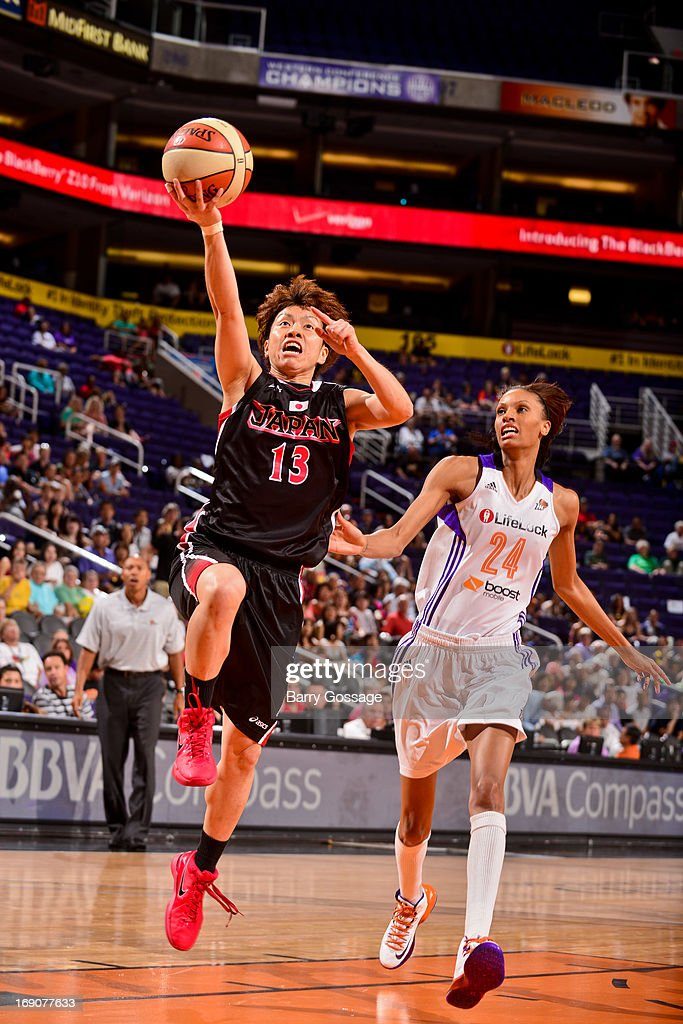Yuko Oga of the Japanese National Team shoots a layup against DeWanna Bonner of the Phoenix Mercury during a WNBA preseason game on May 19 2013 at US...