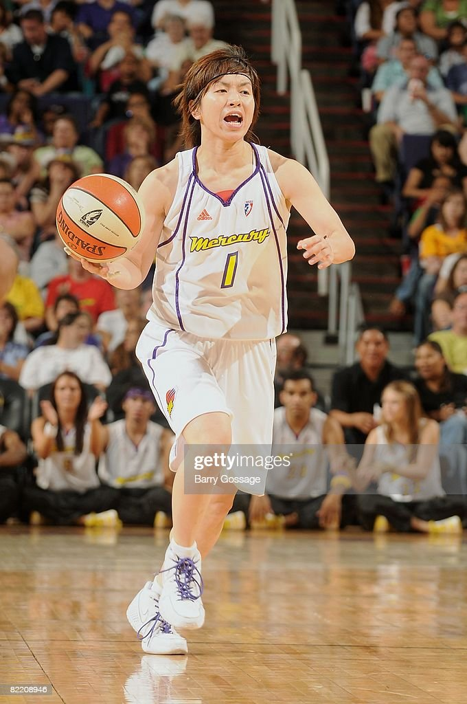 Yuko Oga of the Phoenix Mercury drives the ball up court during the WNBA game against the Seattle Storm on July 25 2008 at US Airways Center in...