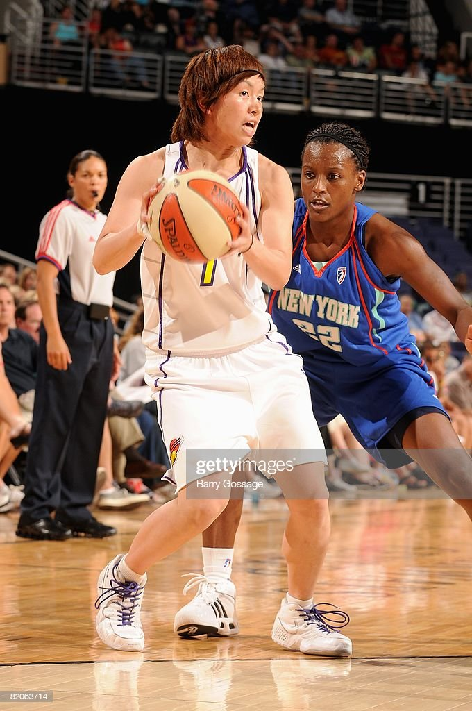 Yuko Oga of the Phoenix Mercury looks to pass under pressure from Ashley Battle the New York Liberty during the WNBA game on July 5 2008 at US...