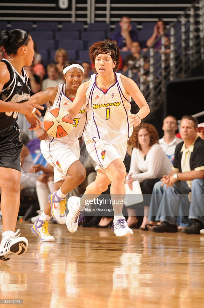 Yuko Oga of the Phoenix Mercury moves the ball against the San Antonio Silver Stars on July 15 at US Airways Center in Phoenix Arizona NOTE TO USER...
