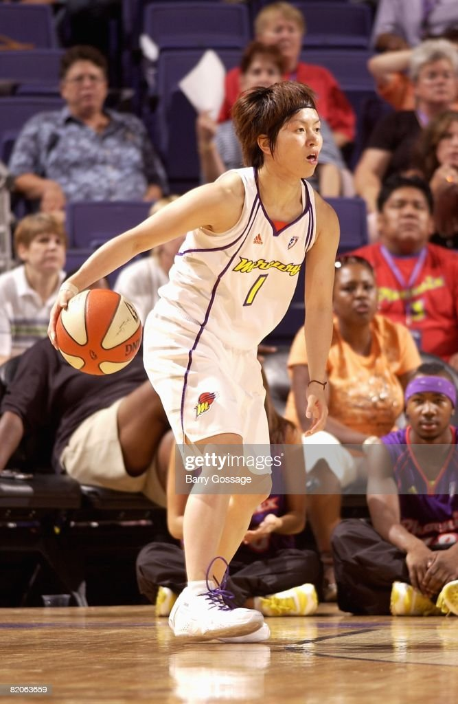 Yuko Oga of the Phoenix Mercury moves the ball during the WNBA game against the New York Liberty on July 5 2008 at US Airways Center in Phoenix...