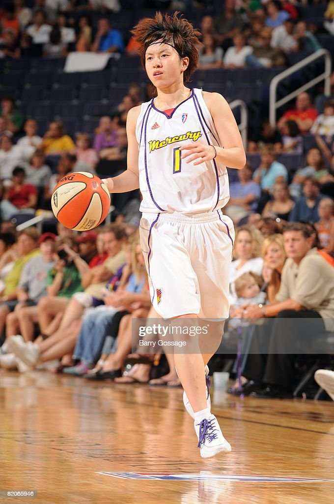 Yuko Oga of the Phoenix Mercury moves the ball up court during a game against the Atlanta Dream at US Airways Center on July 19 2008 in Phoenix...