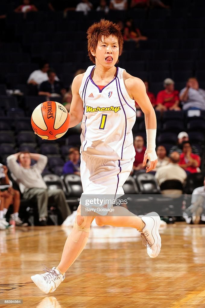Yuko Oga of the Phoenix Mercury moves the ball up court during a WNBA game against the Seattle Storm at US Airways Center on May 30 2009 in Phoenix...