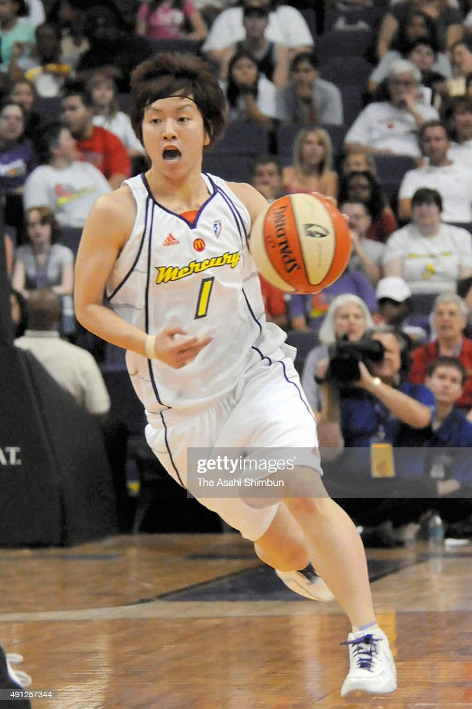 Yuko Oga of the Phoenix Mercury moves the ball up court during the game against the Los Angeles Sparks at US Airways Center on May 17 2008 in Phoenix...