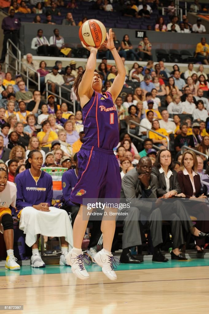 Yuko Oga of the Phoenix Mercury shoots a jumper during the WNBA game against the Los Angeles Sparks on July 6 2008 at Staples Center in Los Angeles...