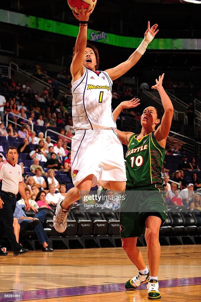 Yuko Oga of the Phoenix Mercury shoots a layup against Sue Bird of the Seattle Storm during a WNBA game at US Airways Center on May 30 2009 in...