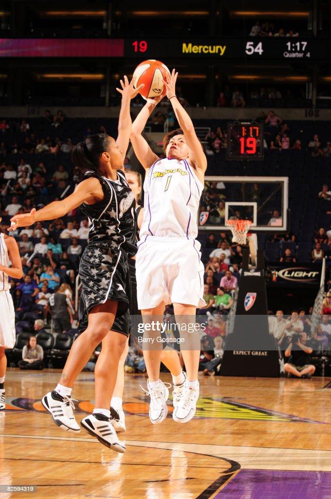 Yuko Oga of the Phoenix Mercury shoots against Edwige LawsonWade of the San Antonio Silver Stars on August 28 at US Airways Center in Phoenix Arizona...