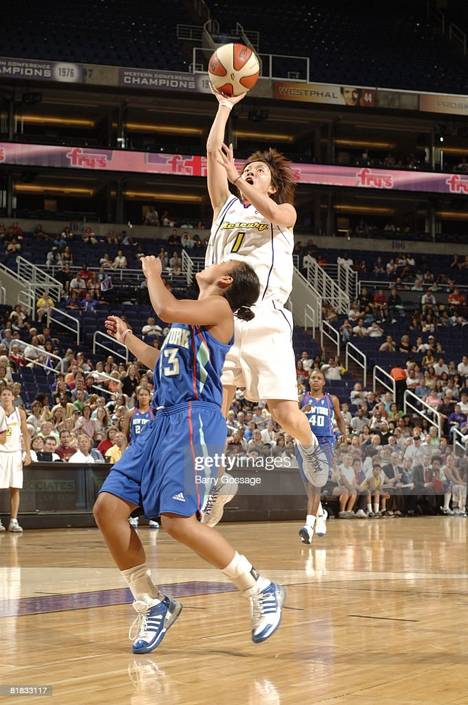 Yuko Oga of the Phoenix Mercury shoots against Leilani Mitchell of the New York Liberty on July 5 at US Airways Center in Phoenix Arizona NOTE TO...